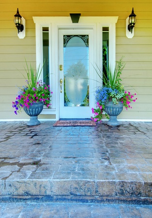 Green house with white door entrance with stone porch. Stock Photo - 13122561