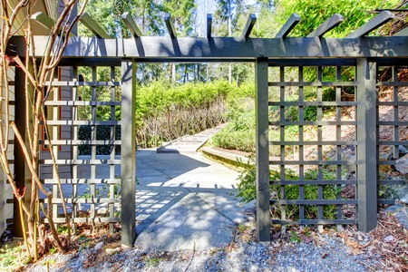 Garden wood gates exterior in the spring time.
