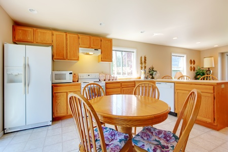 Simple kitchen with table and white appliances. Stock Photo - 13122475