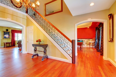 cherry hardwood: Large hallway and staurcase and cherry hardwood floor.