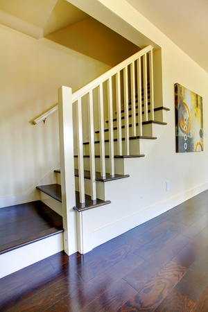 Staircase with dark floor and beige walls in a new home. Stock Photo - 13122521