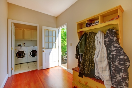 Laundry room with mud room and clothes. photo
