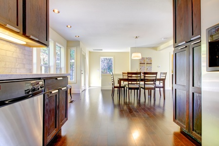 shiny floor: Dining room and kitchen in bright modern home.