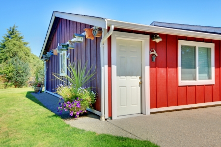 Small shed with red and purple and bird houses. photo