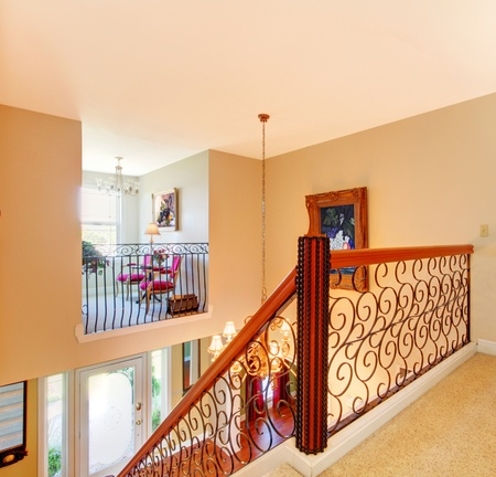Luxury home hallway with metal railings.  photo