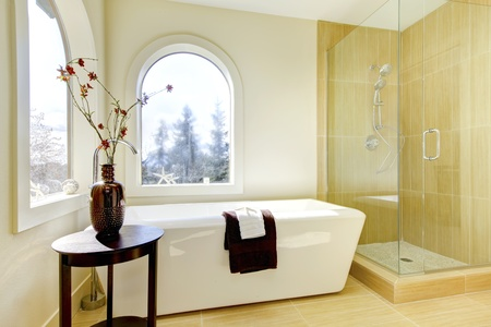 bathroom tiles: Luxury natural classic bathroom with shower and white tub.