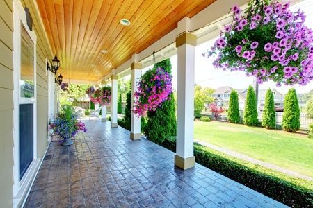 Large luxury porch with beautiful flowers. photo
