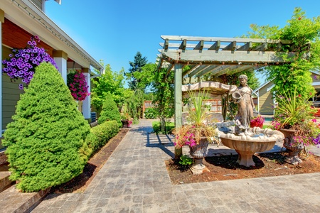 Backyard with outdoor living room and green trees. 스톡 콘텐츠