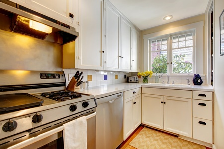 stainless steal: White old kitchen with stainless steal appliances. Stock Photo