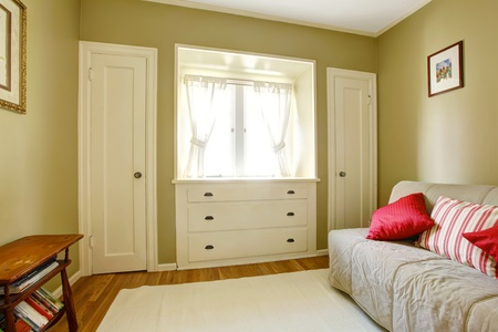 Green bedroom with white doors, sofa  and dresser. Stock Photo - 13163615