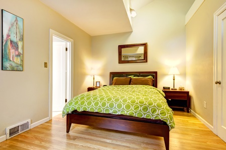 Modern bright green and beige bedroom with brown bed. photo
