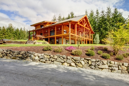 exterior wall: Beautiful Log cabin on the hill with large decks. Stock Photo