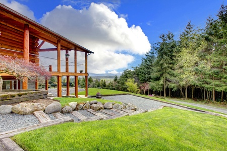 Lof cabin with porch on the hill wth forest view.