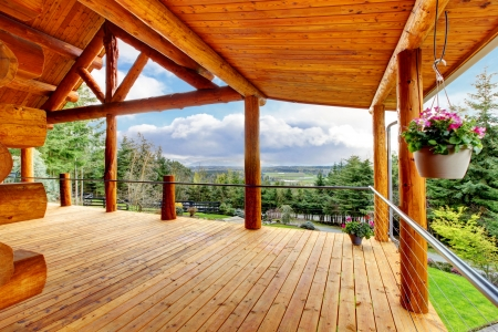 log on: Beautiful view of the log cabin house porch of green valley.