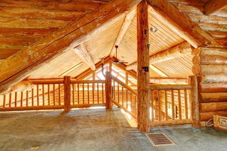 upper floor: Log cabin ceiling and staircase from the upper floor.