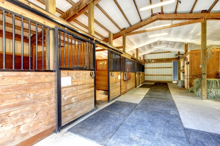 Horse farm stable shed interior with wood doors.