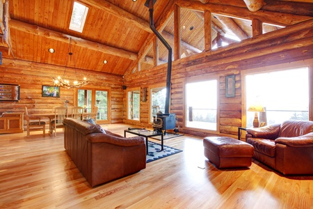 log cabin: Large luxury log house living room with staircase.