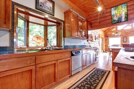 large windows: Large kitchen lof cabin house interior with orange wood. Stock Photo