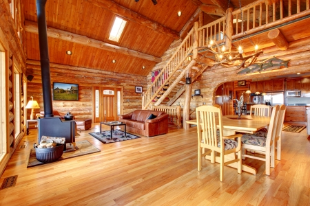 luxury home: Large luxury log house living room with staircase.
