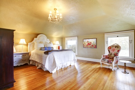 Gold Luxury Bedroom With White Bedding And Maple Hardwood Floor Stock Photo