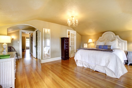 designer: Luxury elegant gold bedroom interior with white bedding and hardwood floor. Stock Photo