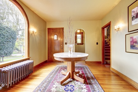 Luxury entrance home inter with round table and hardwood floor. Stock Photo - 13352890