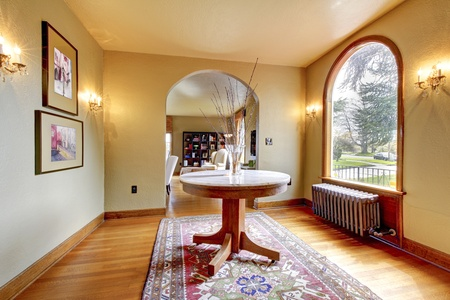 Luxury entrance home interior with round table and hardwood floor. Stock Photo - 13352884