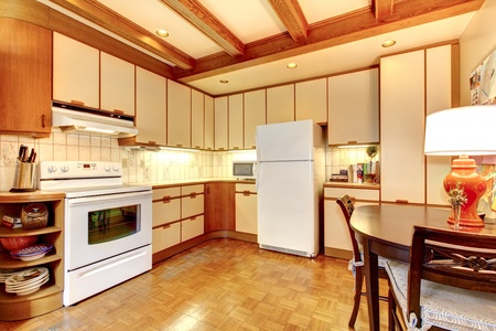 Old simple white and wood kitchen interior with hardwood floor. photo
