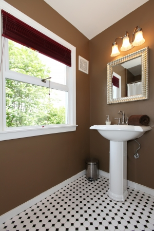 Classy Brown small bathroom with antique sink and tiles photo