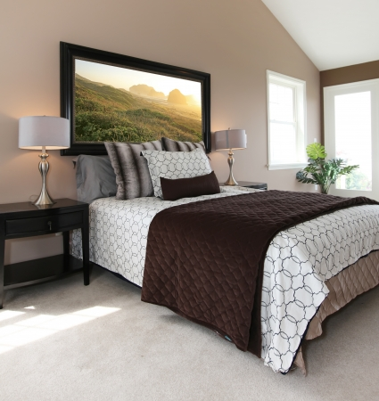 Bedroom with modern white and brown bed and nightstands photo