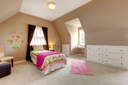 Large brown baby girl bedroom with pink bed and beige carpet.
