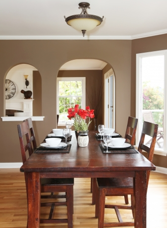 Dining room with brown walls and wood table in the luxury home. photo