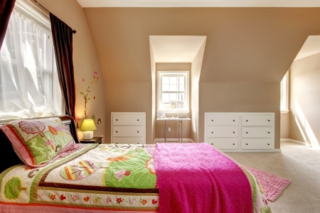 Large brown baby girl bedroom interior with pink bed.