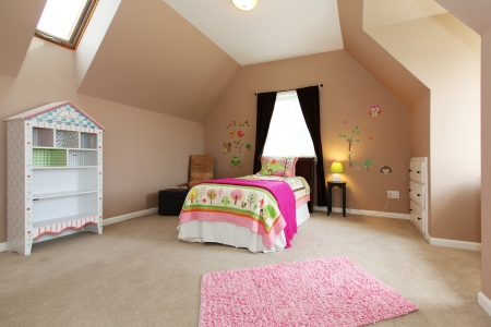 Baby girl kids bedroom interior with pink bed and brown walls. Stock Photo