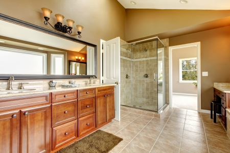 Luxury new large bathroom interior with brown tiles and wood cabinets. Stock Photo - 13888946