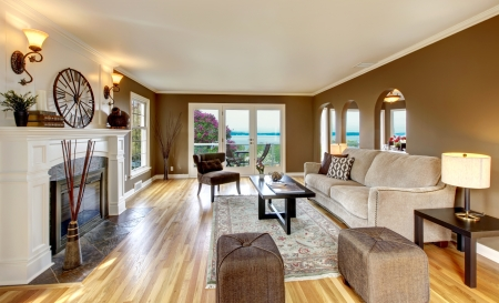 family  room: Beautiful living room with brown walls and fireplace.
