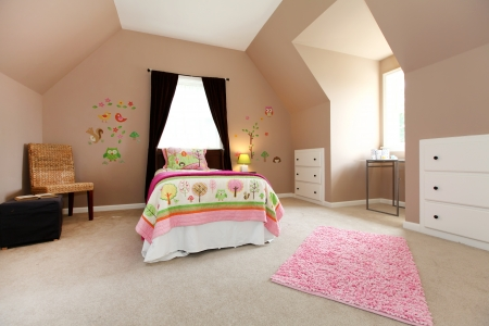Large brown baby girl bedroom interior with high ceiling. photo