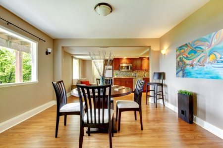 back kitchen: Large bright luxury dining wiith with kitchen in the back and hardwood floor. Stock Photo