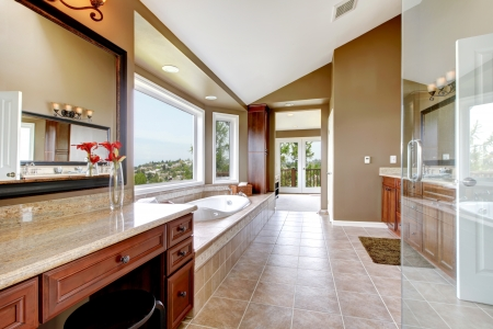 modern bathroom: Large modern luxury new master bathroom in brown.