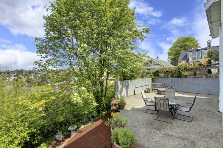 Back yard house terrace with table and chairs and tres. Stock Photo - 13888957