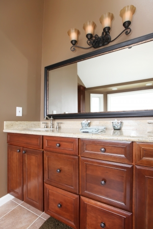 Close up luxury wood bathroom cabinets and mirror with brown walls. Stock Photo - 13888927