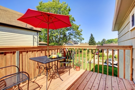 small cozy deck with red umbrella. Stock Photo - 14032756