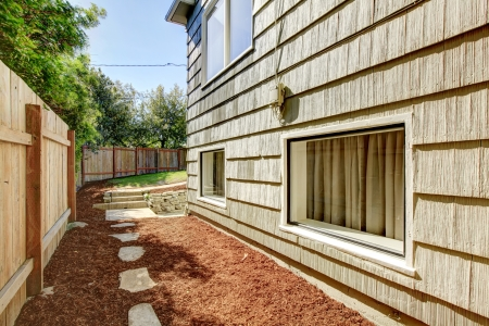 House with fence and space between it. Stock Photo - 14032759