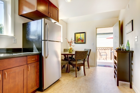 Modern cherry kitchen with steal appliances and open door. Stock Photo - 14032709