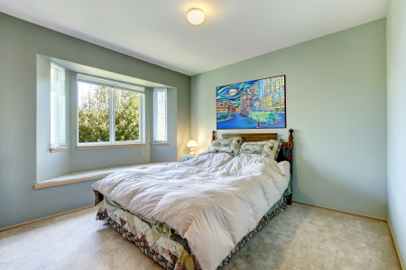 Green simple bedroom with small bed and large window. Stock Photo - 14032743