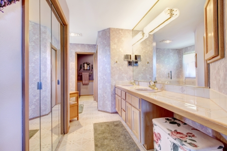 Purple large old bathroom with mirror and long cabinet. Stock Photo - 14032708