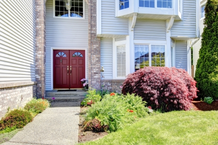 Large American  grey house with red door  Stock Photo - 15783833