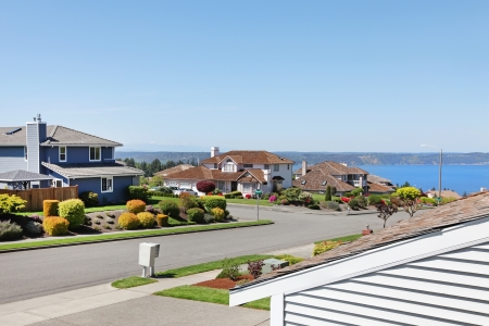 Large houses on the street with water view. American NorthWest. photo