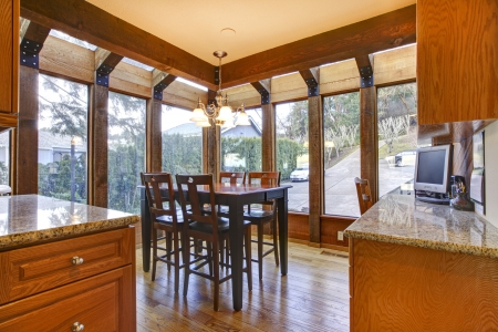 Breakfast room wth wood floor and cherry cabinets.