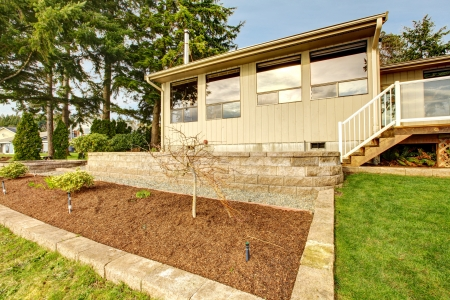 one story: BEige one story house with spring landscape.
